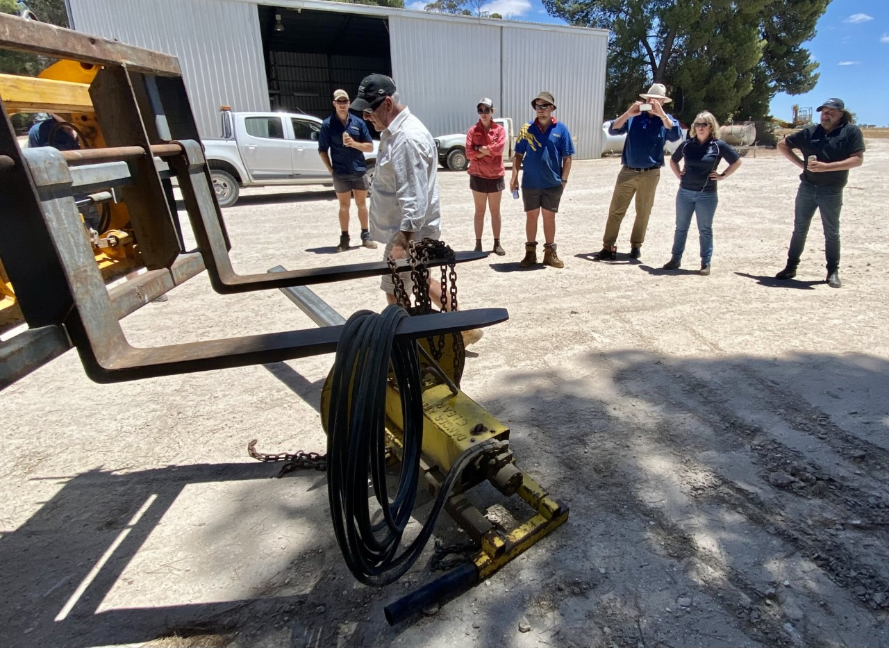 Tony Richman showing the group the Hydraulic Wire Spinner